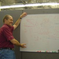 re diaz teaching at a whiteboard
