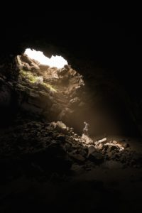 man inside deep cave