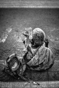 balck and white photo of woman begging alms