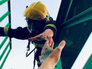 fireman rescuing a person