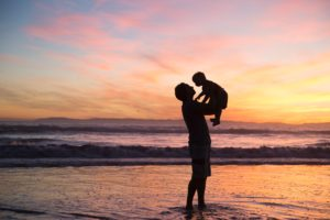 father lifting up child