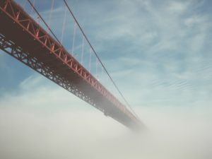 Photo of bridge vanishing into the fog
