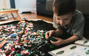 photo of child putting a lego toy together