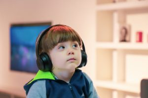 photo of boy with earphones