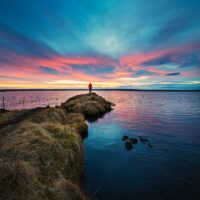 man looking at sunset horizon