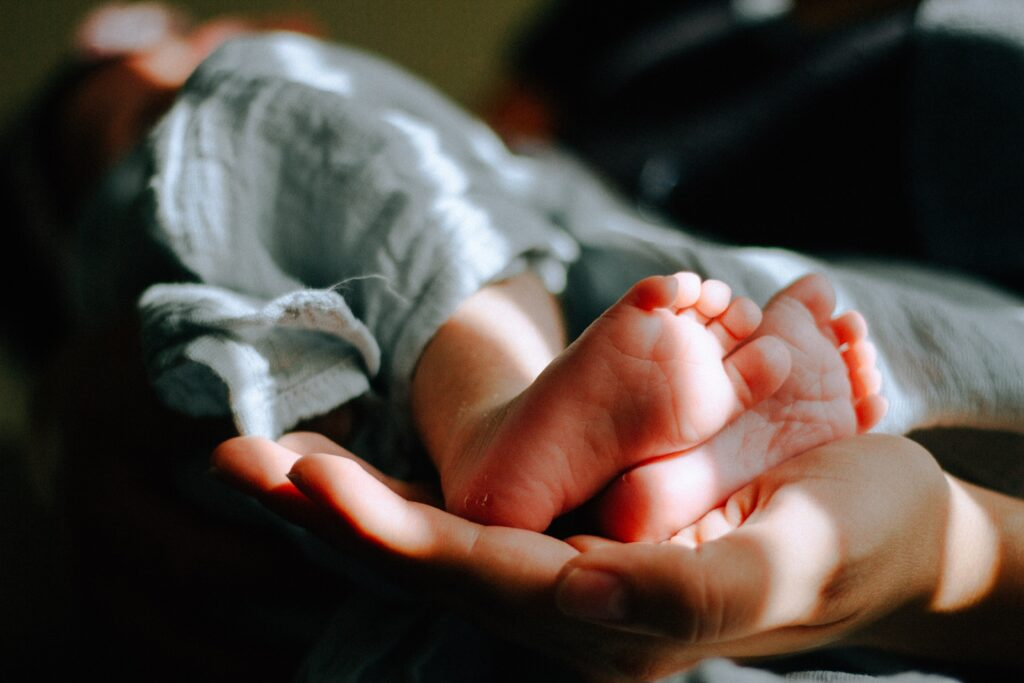 hand holding a baby