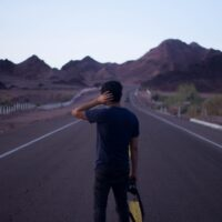 person looking at an open road