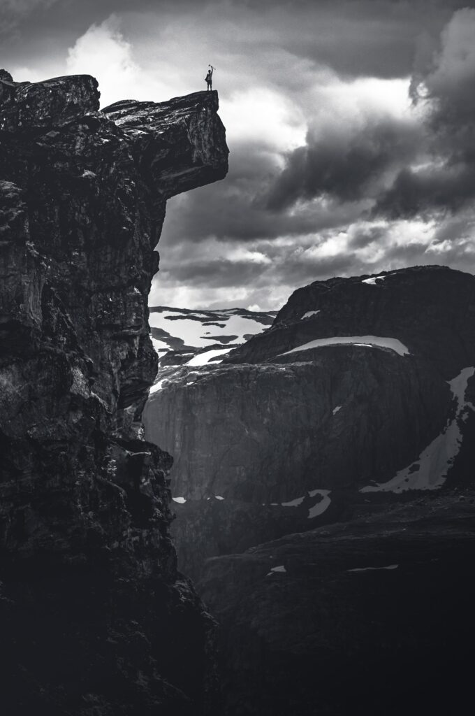 photo of a person on the edge of a cliff