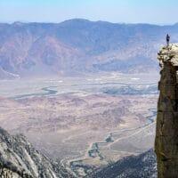 photo of a man at the edge of a precipice