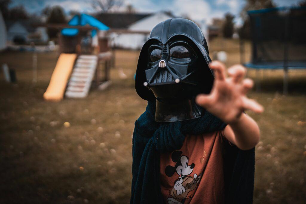 child dressed up as darth vader