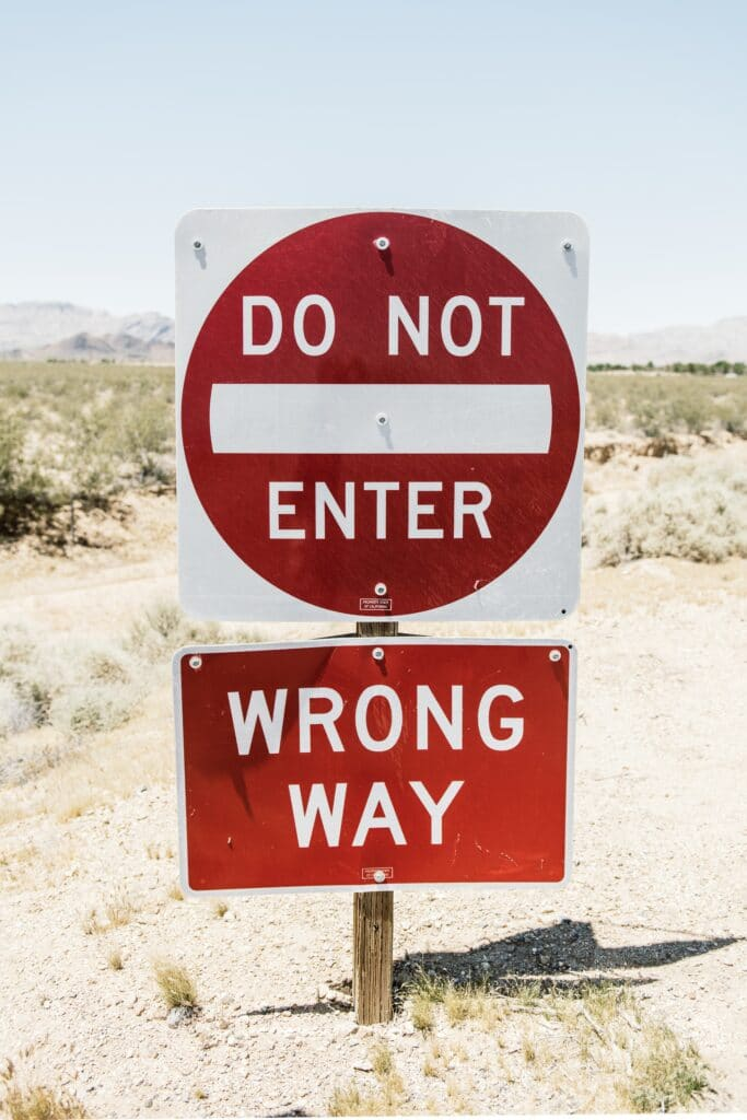 road signs saying: do not enter, wrong way