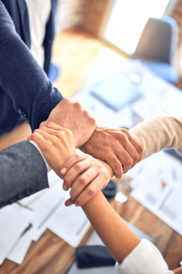 coworker's hands linked together