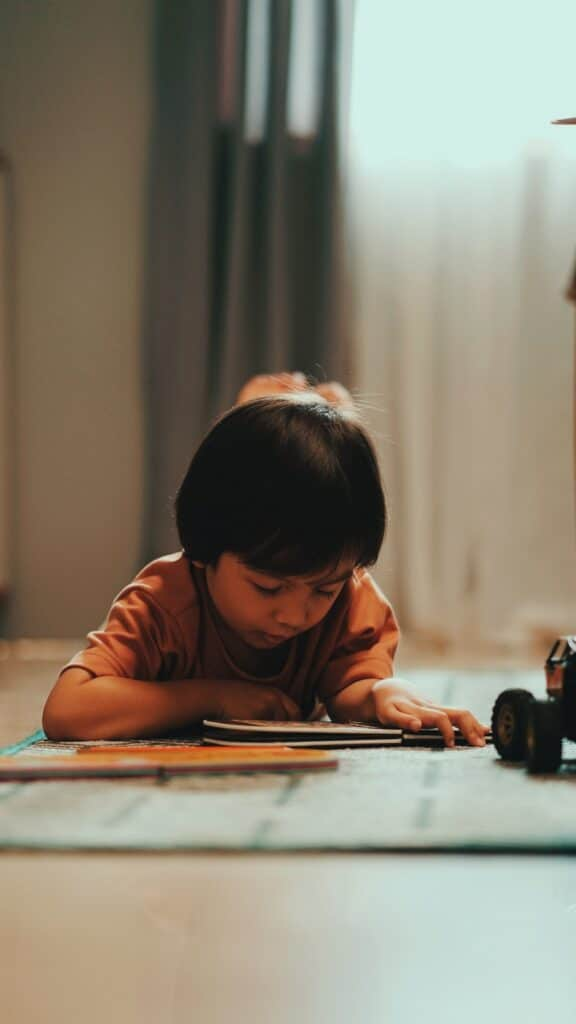 photo of child reading a book